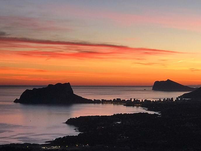 Sunset view from Cumbre del Sol down the coast to the Ifach rock