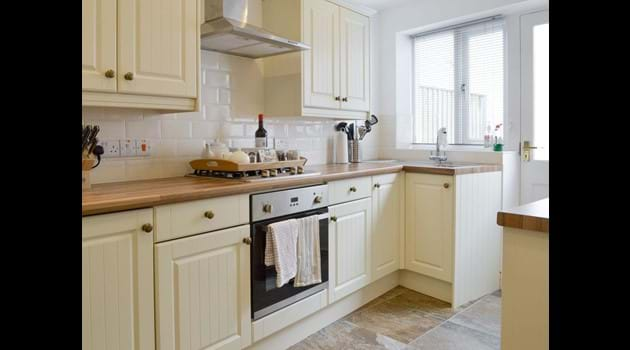Kitchen with fridge freezer, washer/dryer, dishwasher, gas hob, electric cooker and microwave