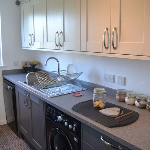 Galley kitchen with full size dishwasher and washing machine