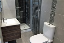 Ensuite to master bedroom with vanity unit & washbasin, led mirror and shaving point, shower cubicle and wc
