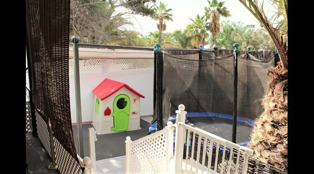 gated play area overlooked by the sofa in the shade