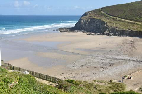 Porthowan beach with the south west coast path on the cliff.