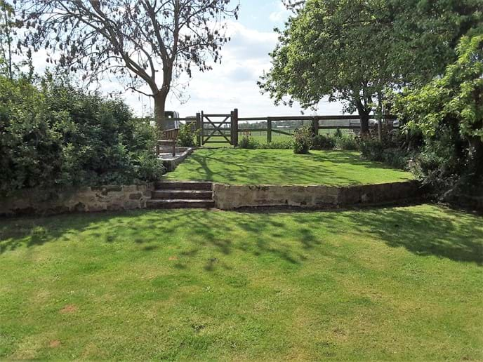 The back garden, three acres of paddocks accessed through the gate