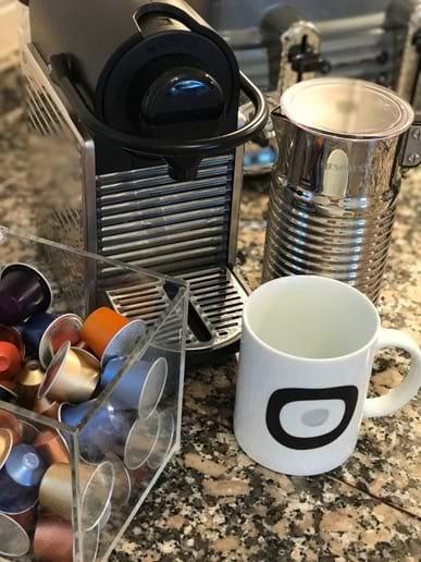 Nespresso, Aeroccino, and coffee mugs