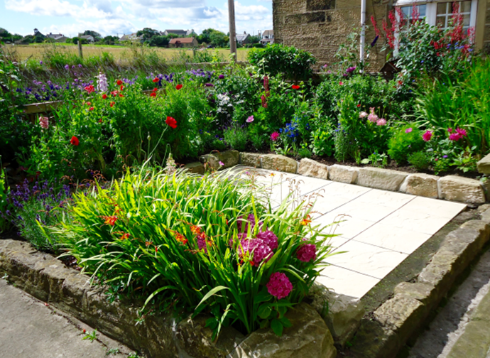 The pretty cottage garden at the front of Anchor Cottage