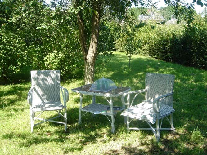 relaxing on the Chateau chairs in the orchard
