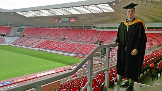 Angelos at his graduation at the Stadium of Light