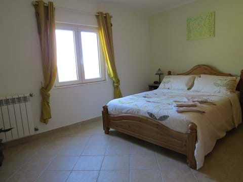 Bedroom 1 with king sized bed and en suite