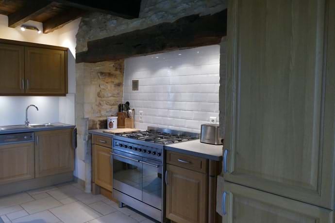 Fully fitted and integrated kitchen with a Smeg cooking range
