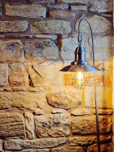 The stone walls give the cottage great character