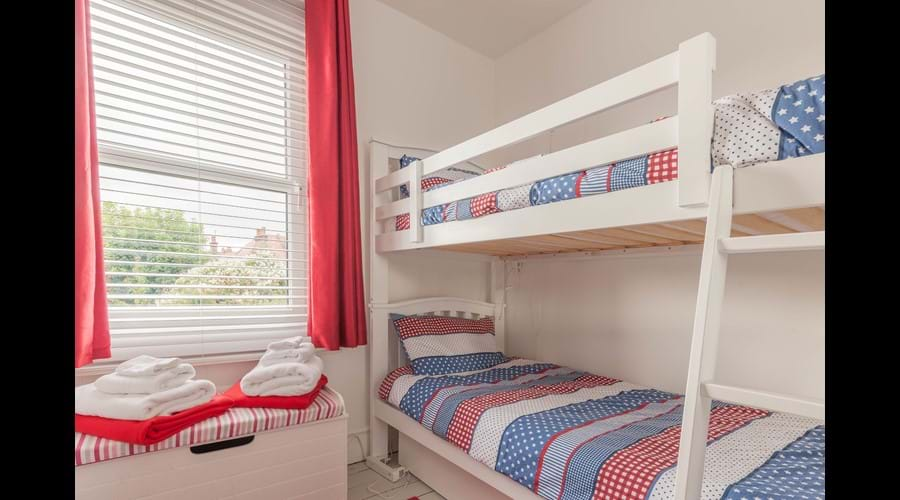 The bunk bed room has a bright, fun colourscheme that children love