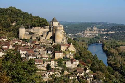 The village of Beynac and Cazenac is perched on a cliff side and overlooks the Dordogne