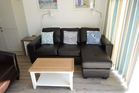 The new corner sofa, tub chair and coffee table.