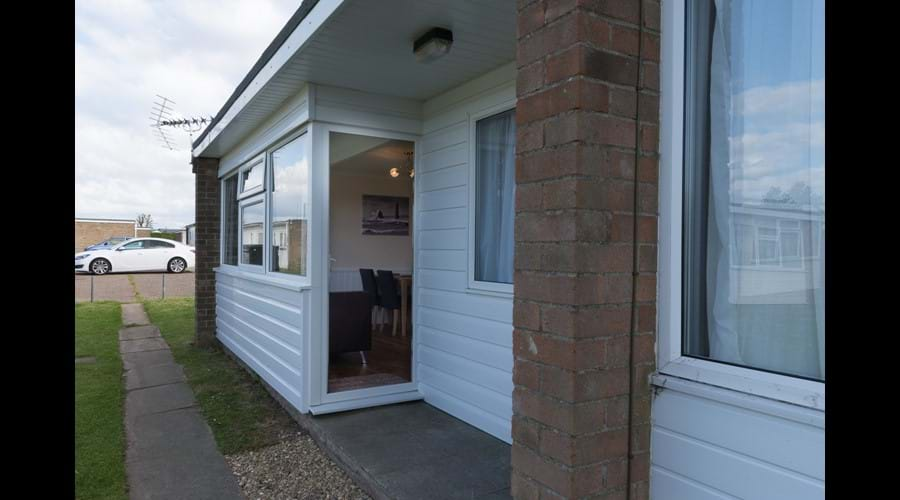 Open porch with communal grassed area to front