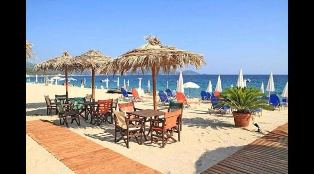 latchi Beach - tables with palm shades on golden sands