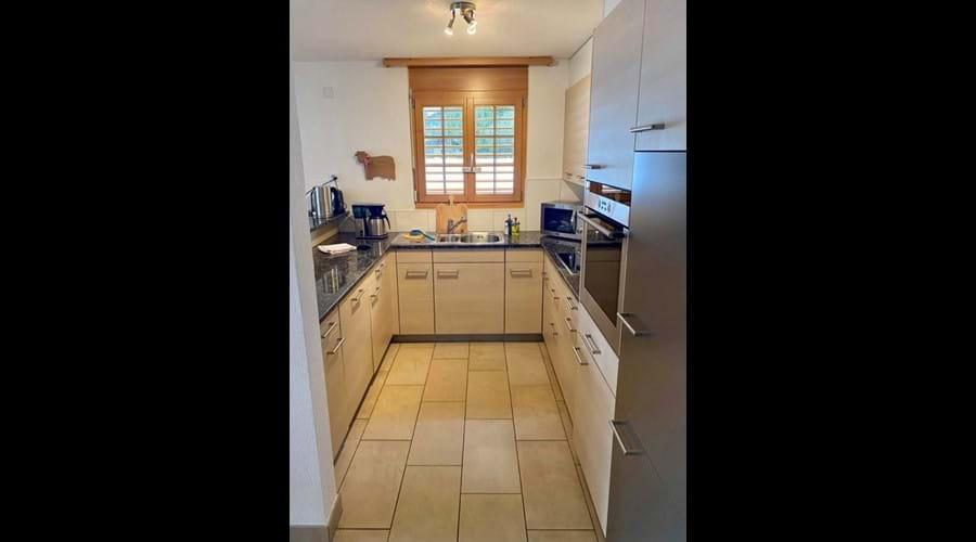 Cooks kitchen with fridge freezer