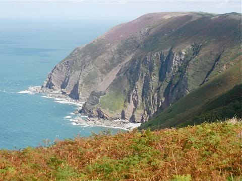 A view of steep cliffs and the sea at Trentishoe in North Devon