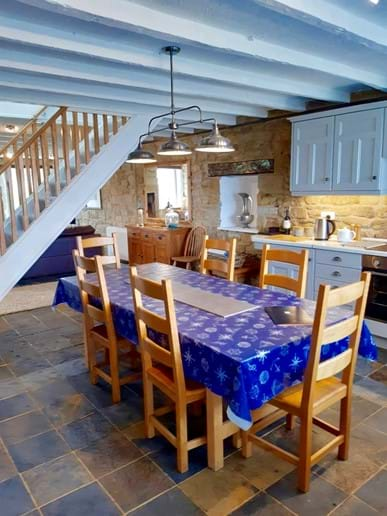 The kitchen is separated from the living area by the beautiful oak staircase. There is a slate tiled floor throughout the ground floor.