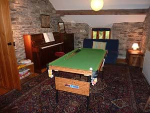 Games room with piano, double futon & small snooker table