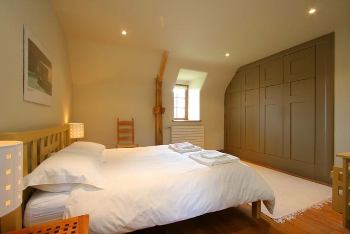 One of the double bedrooms in the Farmhouse with plenty of wardrobes
