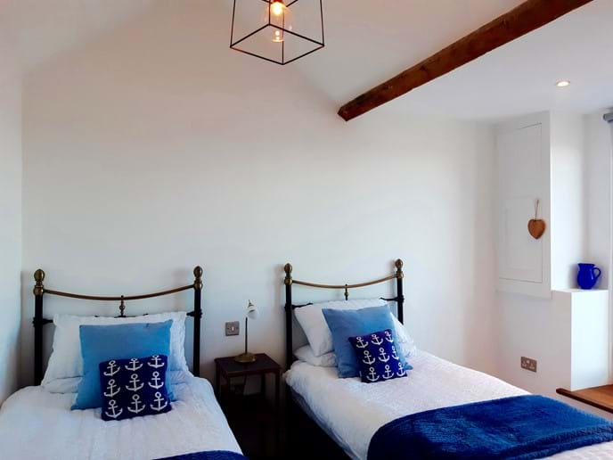 The second bedroom has twin beds