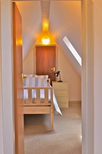 There is a door between 2 rooms.