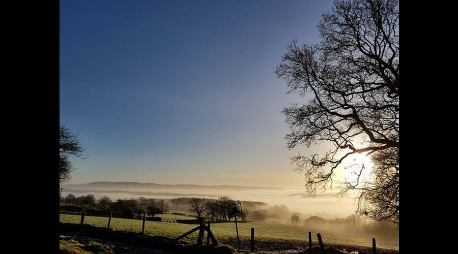 The view on a misty day heading towards Builth Wells