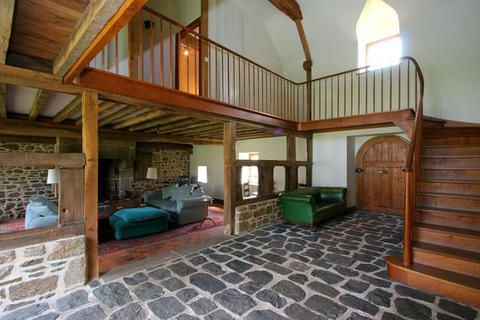 The hall in The Barn at Boudet showing the door to the front orchard. Sitting room to the left and open plan dining room to kitchen to the right
