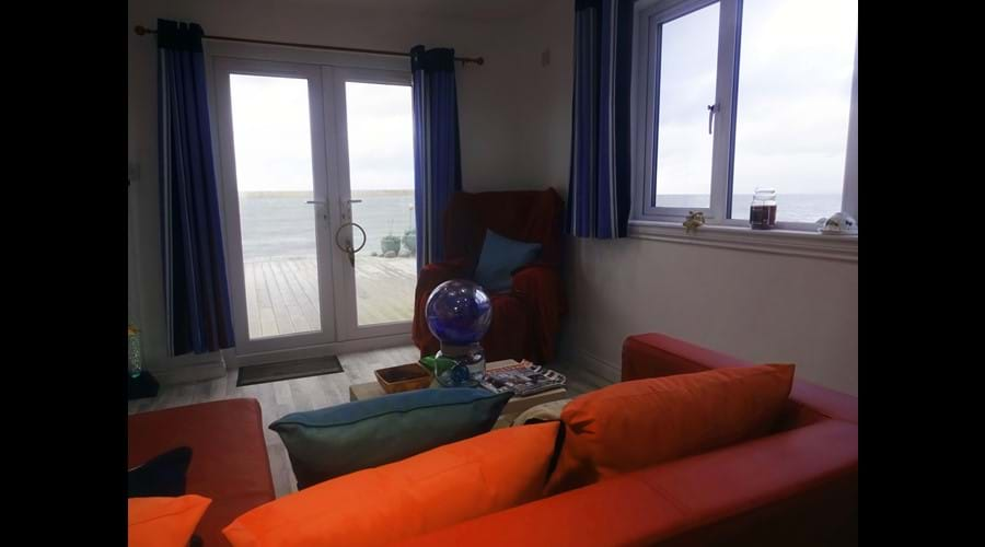 cabin with double bed, sofa area, TV and large shower room. Ideal for a restful escape. Seaview from every window