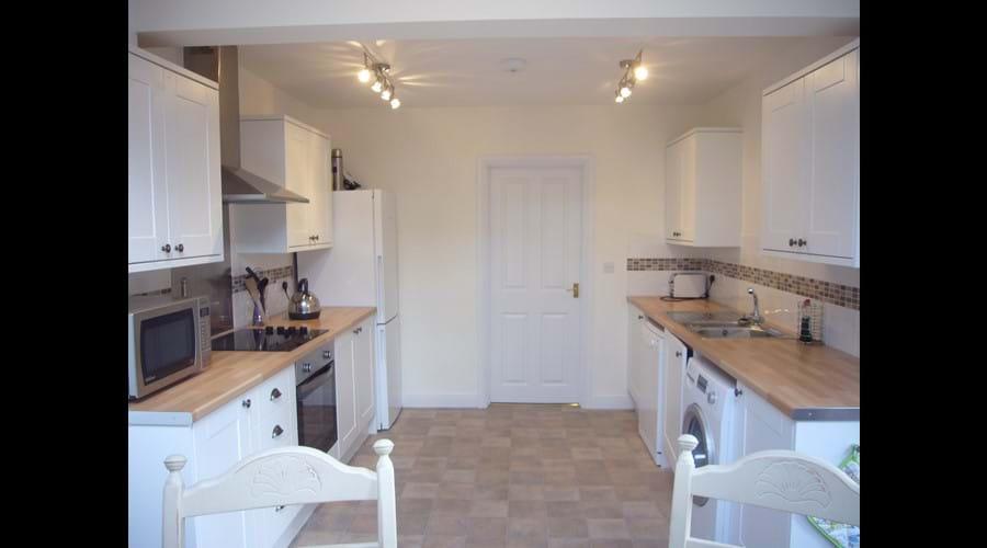 Dishwasher, microwave, fridge freezer and washing machine.