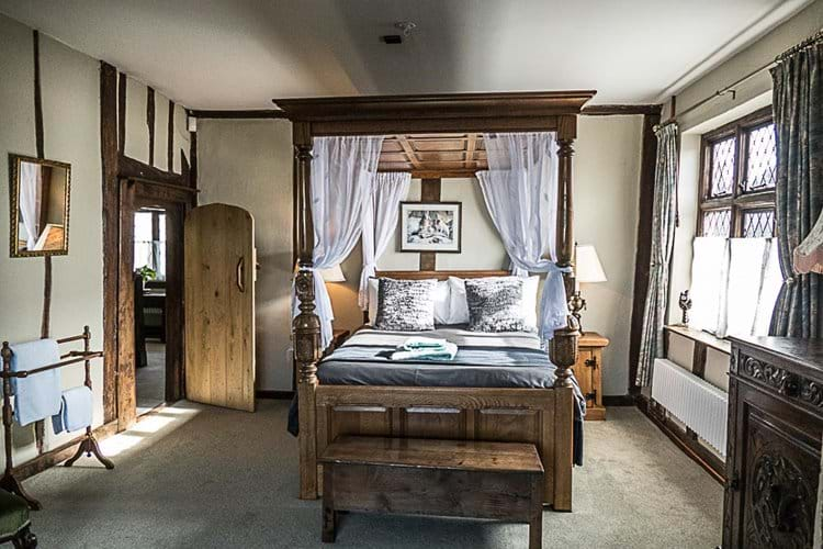 Another view of bedroom with four poster bed