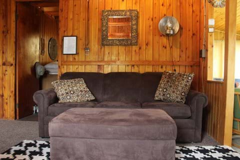 Full size sleeper sofa with ottoman that opens for blanket storage.