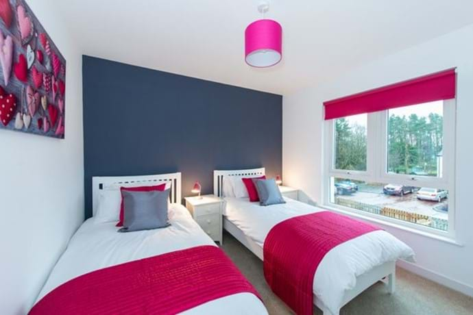 Modern and sunny twin bedroom overlooking rear garden
