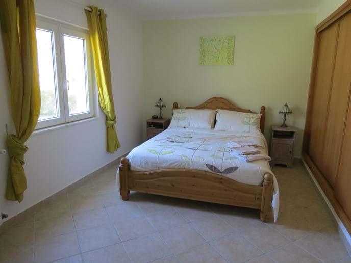 Bedroom 1 with ensuite, king size bed, sliding wardrobes, window to rear garden