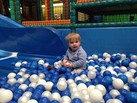 Someone loves the ball pit at the Brecon Play Barn.