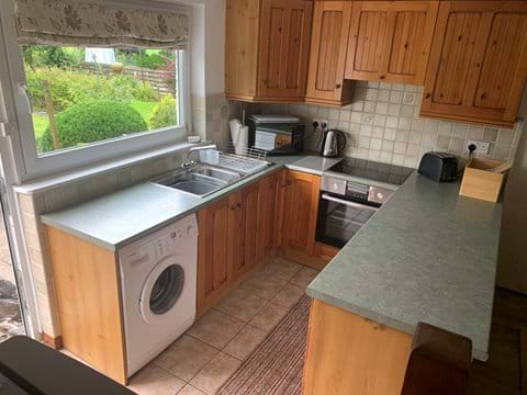 Modern well equipped kitchen with views of Keldas and Place Fell