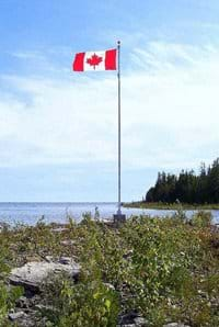 The Canadian Flag flying proudly on the distant point.