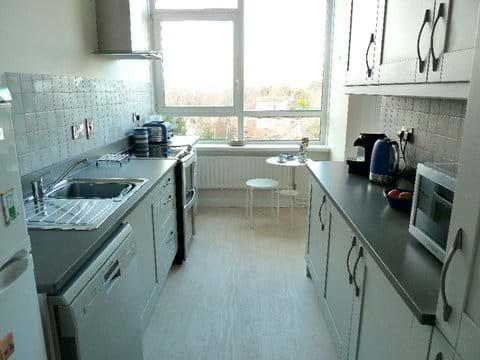 Bright modern kitchen. Plenty of machines!