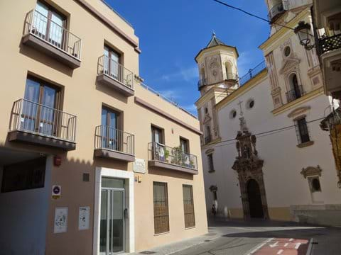 Apartment building and church of San Felipe Neri