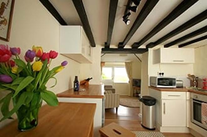 Photo showing open plan kitchen dining and lounge area self catering cottage for two near Criccieth