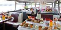 Lovely afternoon tea on a vintage bus