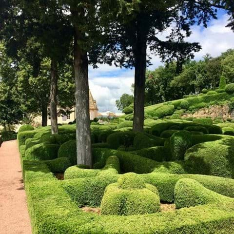 Gardens of Marqueyssac, paths next to trees and green cut topiary