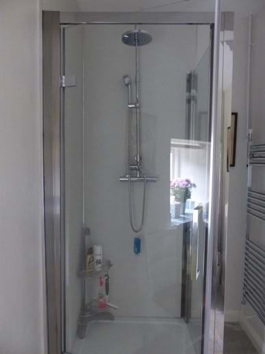 Shower enclosure in downstairs cloakroom