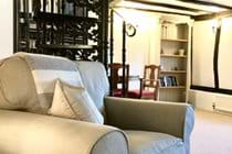 The spiral staircase to the landing and second bedroom is a quirky feature of this boutique, self-catering holiday cottage near Bury St Edmunds