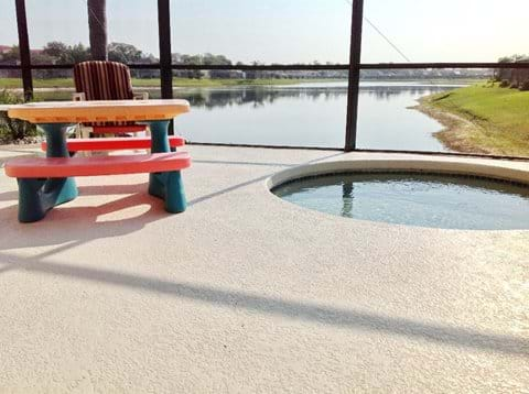 Childrens pool and seating on the decking area overlooking Sunset Lake