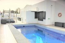 Sofa overlooks to pool