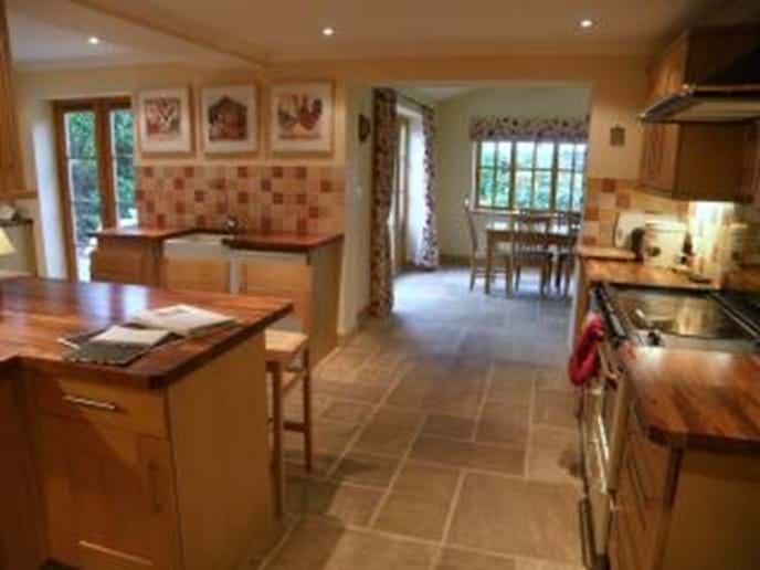 A large, fully equipped kitchen, with Aga