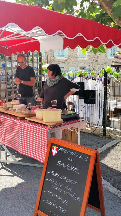 Local producers sample their wares in the village square