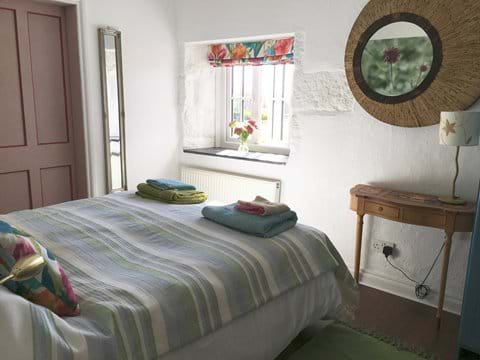 Bedroom with lovely views over the pond and garden. Twin or Kingsize bed