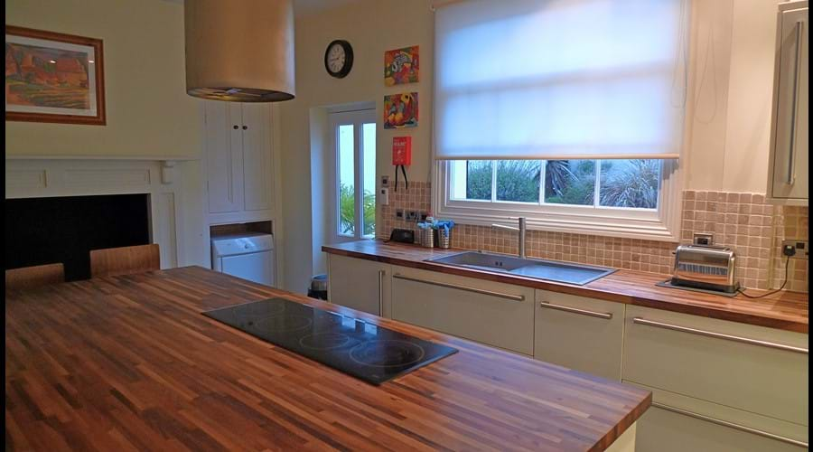 Kitchen with large island and 7 barstools